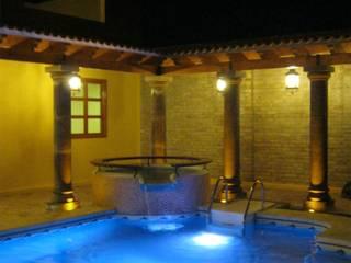 Casa de descanso fl Piscinas coloniales de IPALMA ARQUITECTOS Colonial