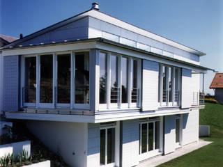 Einfamilienhaus in Uettligen Moderne Häuser von R. + A. Gonthier Architekten Modern