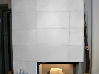 Architectural concrete slabs as a housing of the fireplace Minimalist living room by Luxum Minimalist