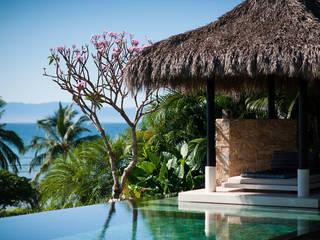 Villa Siriyana Albercas tropicales de Stone Contractors Tropical