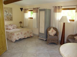 Les maisons de chante oiseau Country style bedroom