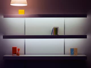 White shelving with lighting and silver anodised aluminium wall fixings:   by ON&ON