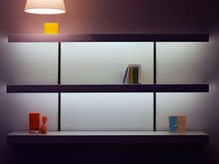 White shelving with lighting and black wall fixings:   by ON&ON