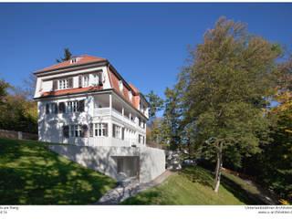Fels am Hang Klassische Häuser von Unterlandstättner Architekten Klassisch