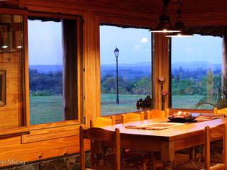 Otros interiores de Patagonia Log Homes: Comedores de estilo rural por Patagonia Log Homes