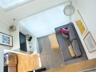 Loft em Moema, São Paulo: Salas de estar  por Liliana Zenaro Interiores,
