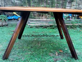 Mesa comedor hecha con madera reciclada y piedra. de MuebleArte Rústico