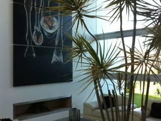 Salas / recibidores de estilo  por ARKIZA ARQUITECTOS by Arq. Jacqueline Zago Hurtado