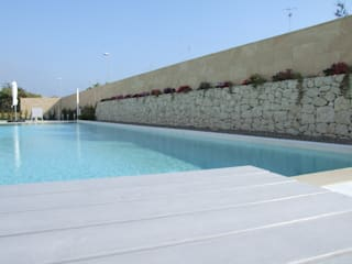 Salento Village & Residence: Hotel in stile  di UZone Design