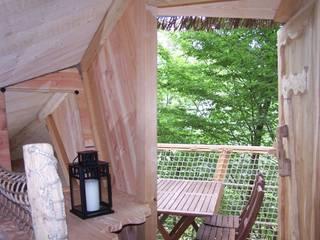 La terrasse pour le petit-déjeuner:  de style  par Parc de Fierbois