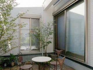 Modern Garden by 鶴巻デザイン室 Modern
