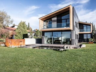 Casas de estilo  por 21-arch GmbH