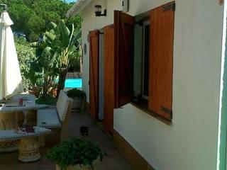 Porticones de madera Casas de estilo rústico de FUSTERS CÓRDOBA Rústico