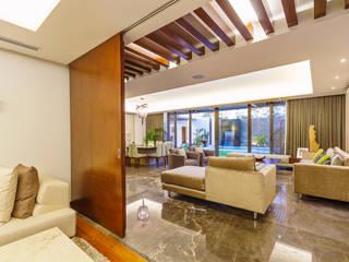 Casa Manantiales: Salas de estilo  por Enrique Cabrera Arquitecto