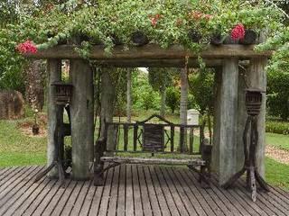 Jardines de estilo rústico de Roncato Paisagismo e Comércio de Plantas Ltda Rústico