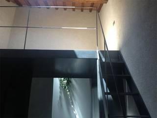 DPd Delogu Pettini Architetti Associati Colonial style corridor, hallway& stairs