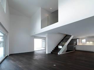 Einfamilienhäuser Weizenacher, Zumikon:  Wohnzimmer von René Schmid Architekten AG
