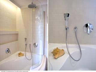 Minimalist bathroom by DoMilimetra Minimalist
