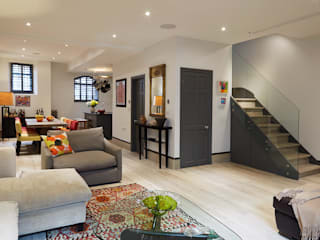 OPEN PLAN LIVING, DINING AND KITCHEN:  Living room by IS AND REN STUDIOS LTD