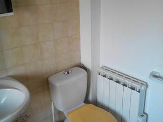 Avant: Salle de bains de style  par Atelier Cuisine