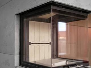Beton architektoniczny jako obudowa kominka Nowoczesny salon od Luxum Nowoczesny
