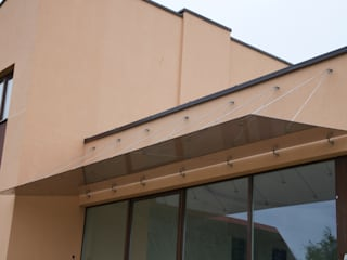 Glass Canopy with wall-suspended supports :  Terrace by Inox City Ltd