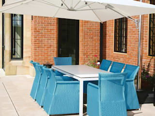 Rattan and Metal garden dining set with blue rattan armchairs and modern, white aluminium and glass table: modern  by Ingarden Limited, Modern