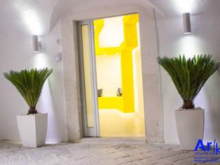 LOG_Studio Ingresso, Corridoio & Scale in stile moderno di arkfattoriale Moderno