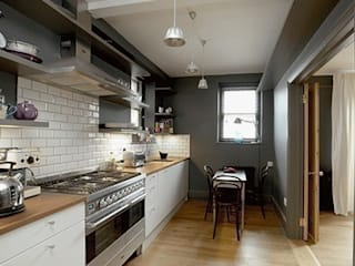 Oak flooring and metro tiles:  Kitchen by Forster Inc