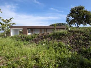 飯塚の家: 松本匡弘建築設計事務所が手掛けた家です。