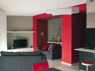 Ristrutturazione di appartamento: Soggiorno in stile  di Archisign