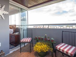 Apartamento 303: Terraços  por Estúdio Barino | Interiores,Rústico