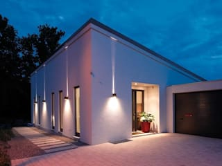 Casas prefabricadas de estilo  por FingerHaus GmbH - Bauunternehmen in Frankenberg (Eder)