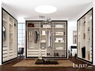 Interior Armario- vestidor con el sistema de módulos Alvic. de ALVIC Moderno