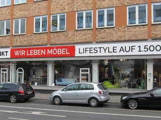 Lojas e Espaços comerciais modernos por Roter Punkt GmbH Moderno