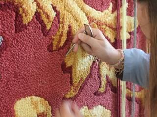 Fabricación de alfombras artesanales:  de estilo  de Alfombras Baldomero S.L.