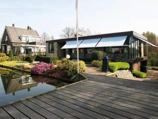 Achter de dijk - Verbouwing van een jaren 60 bungalow tot familievilla : modern  door ara | antonia reif architectuur, Modern
