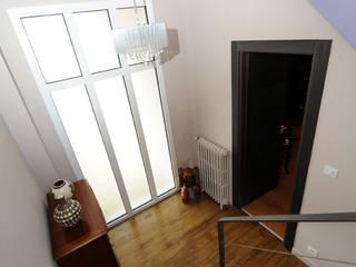 Rénovation intérieur d'une habitation des années 30: Couloir et hall d'entrée de style  par claude LE BORGNE Architecte d'Intérieur CFAI N°857