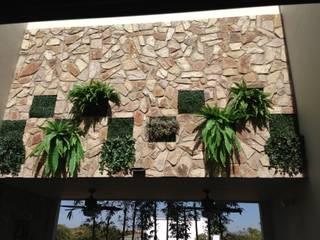casa 240 Jardines modernos de Hussein Garzon arquitectura Moderno