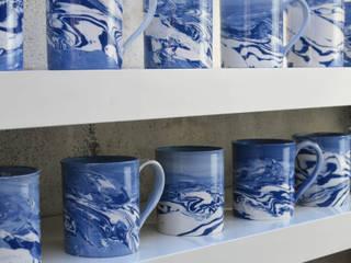 Blue and White Ceramic Tea Mugs:   by Nom Living