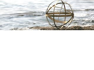 Brass Armillary Sundial dial looking great on the sea front:   by Border Sundials Ltd
