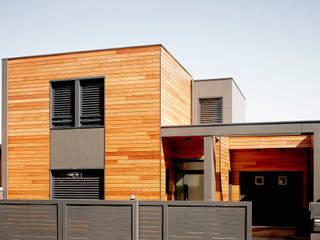 Nowoczesne domy od Cendrine Deville Jacquot, Architecte DPLG, A²B2D Nowoczesny