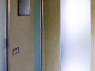 VIA BEROALDO, BOLOGNA Ingresso, Corridoio & Scale in stile moderno di Studio Ethos Project Moderno
