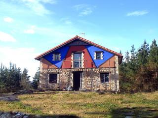 Reabilitación de un caserío vasco:  de estilo  de Casastar Global Building S.L.