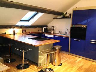 Rénovation d'un appartement: Cuisine de style de style Moderne par AD2