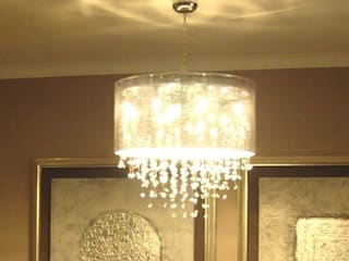 RESIDENCE OF MR.GAUR, GREATER NOIDA FOYER INTERIORS Dining roomLighting