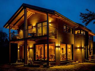 Moderner Landhausstil - Fassade mit Douglasienholzverschalung:  Häuser von architektur. malsch - Planungsbüro für Neubau, Sanierung und Energieberatung