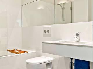 DEPOIS - Casa de Banho: Casas de banho  por Germano de Castro Pinheiro, Lda