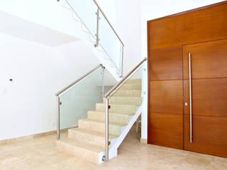 Casa T Pasillos, vestíbulos y escaleras modernos de Enrique Cabrera Arquitecto Moderno