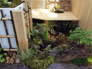 縁側から聞こえる水辺の音色 モダンな庭 の 株式会社 髙橋造園土木 Takahashi Landscape Construction.Co.,Ltd モダン